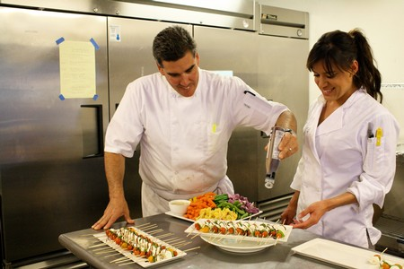 Chef and Sous Chef working on preparing a delicious course of food